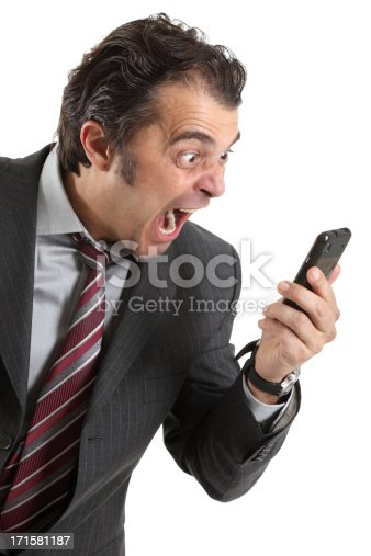 865714662istockphoto Stressed young businessman screams in telephone 171581187