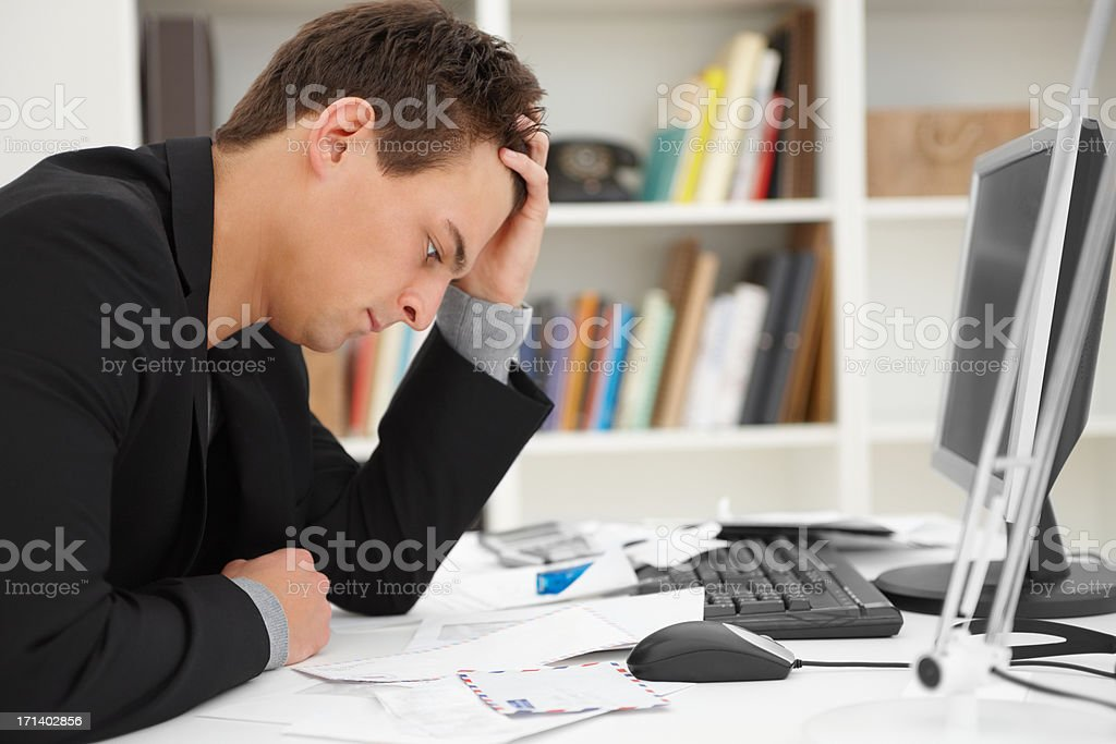 Stressed young man at home desk royalty-free stock photo