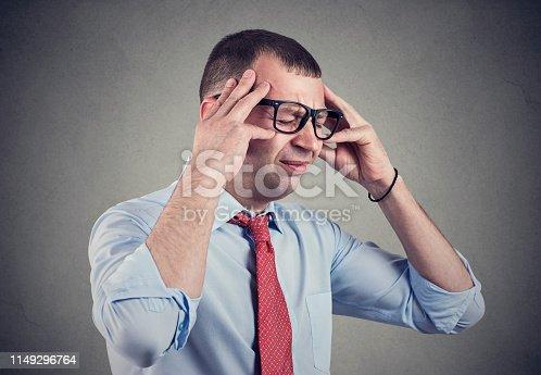 istock Stressed young man having headache 1149296764