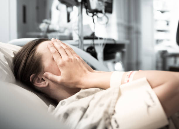 Stressed young woman patient at the hospital stock photo