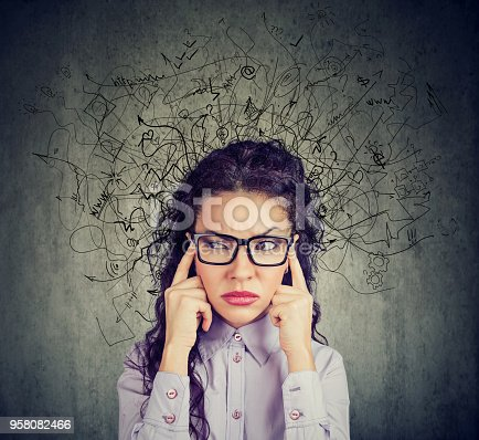 istock stressed young woman with a mess in her head 958082466
