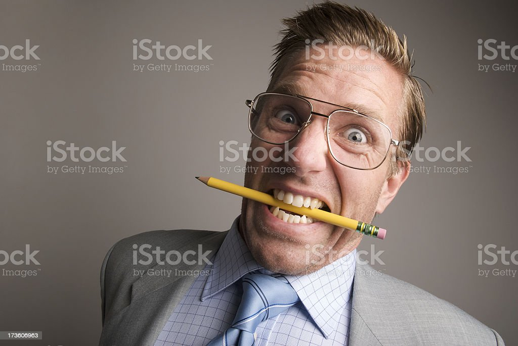 Stressed-Out Businessman Bites Pencil royalty-free stock photo
