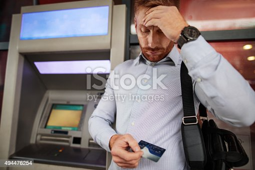 istock Stressful businessman doesn't have enough money on his credit ca 494476254