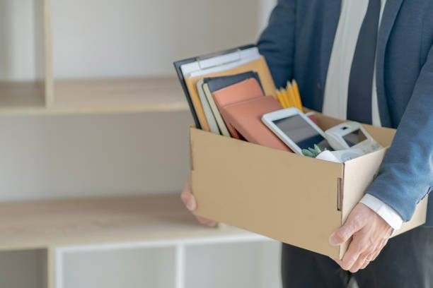 Stressful businessman packing a box for quit a job. Stressful businessman packing a box for quit a job. downsizing unemployment stock pictures, royalty-free photos & images
