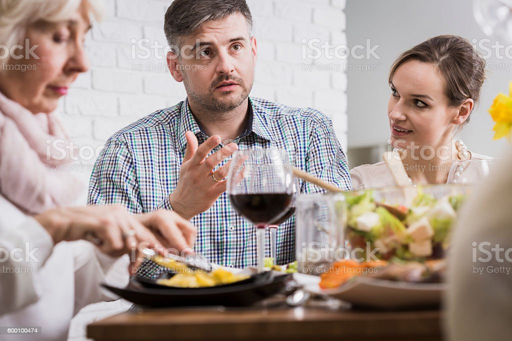 Stressful dinner with parents-in-law stock photo