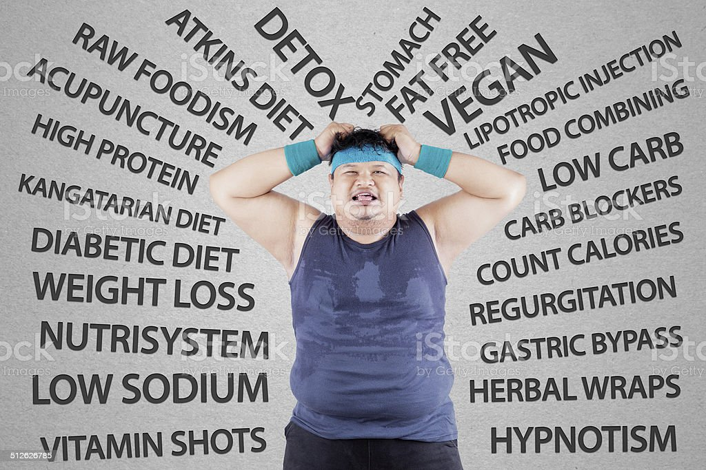 Stressful man having weight problem stock photo