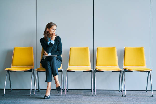 Stressful young woman waiting for job interview Stressful young woman waiting for job interview apprehension stock pictures, royalty-free photos & images