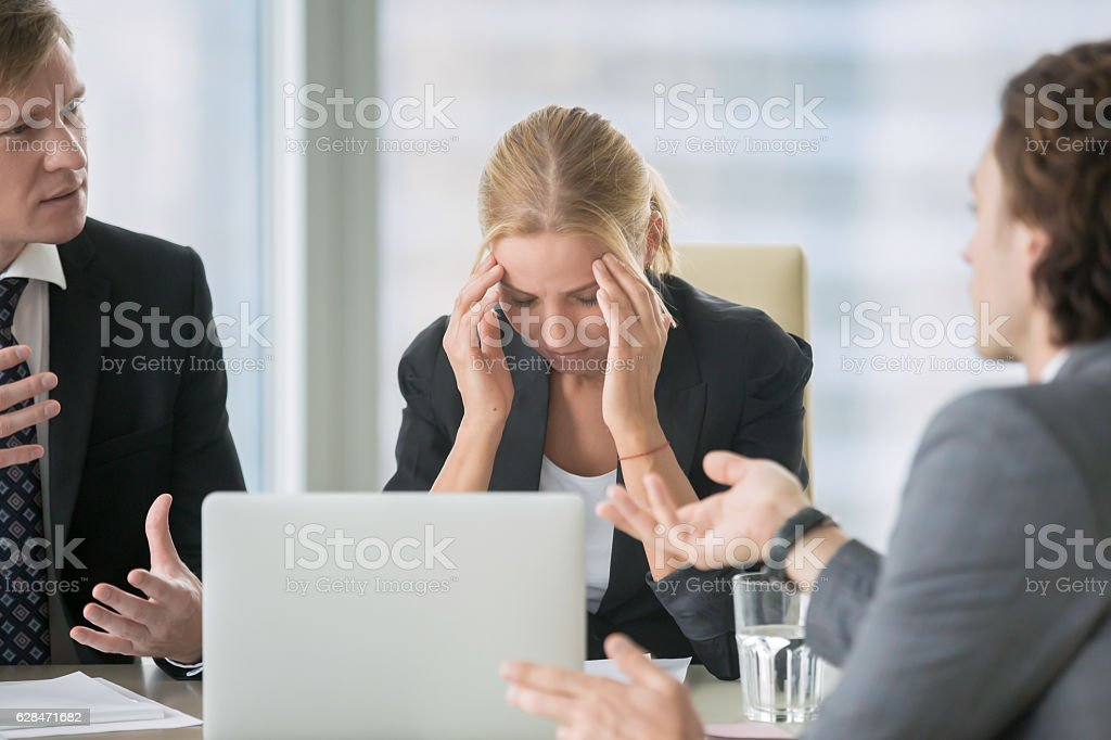 Stressing atmosphere at business meeting stock photo