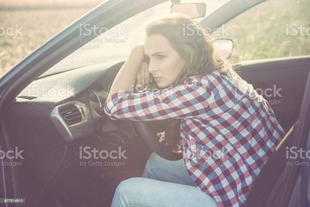 Stressing woman in car stock photo