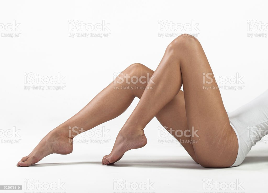 Stretch marks on woman's buttocks stock photo