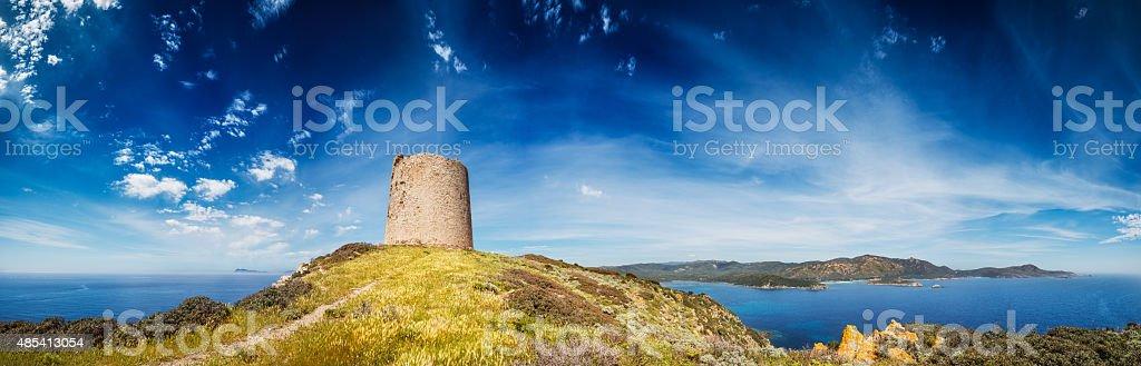 Stretch of Mediterranean coastline in Sardinia with ancient watchtower stock photo