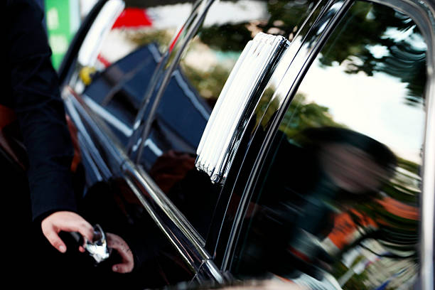 stretched limo & chauffeur - limousine service stock photos and pictures