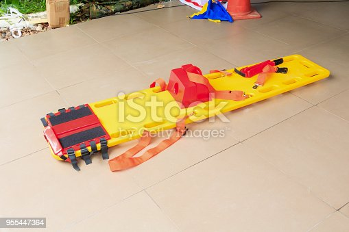 istock stretcher for emergency paramedic service EMS medical equipment on tile background 955447364