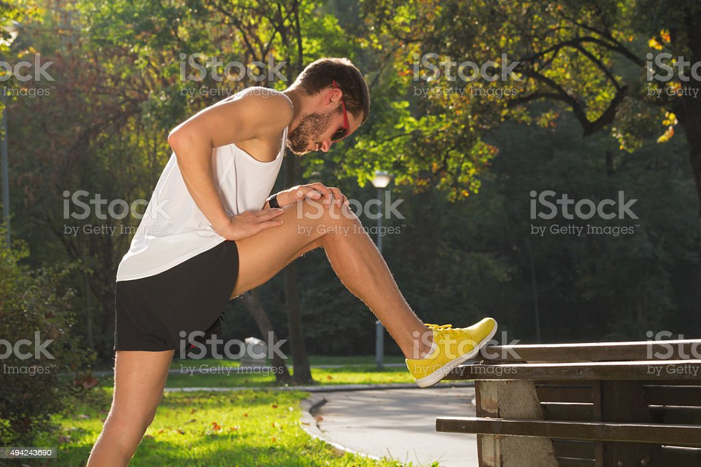Stretching after jogging/excercise - Royalty-free 2015 Stock Photo