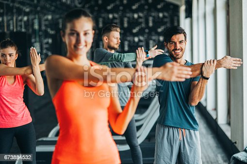 istock Stretching at the gym 673884532