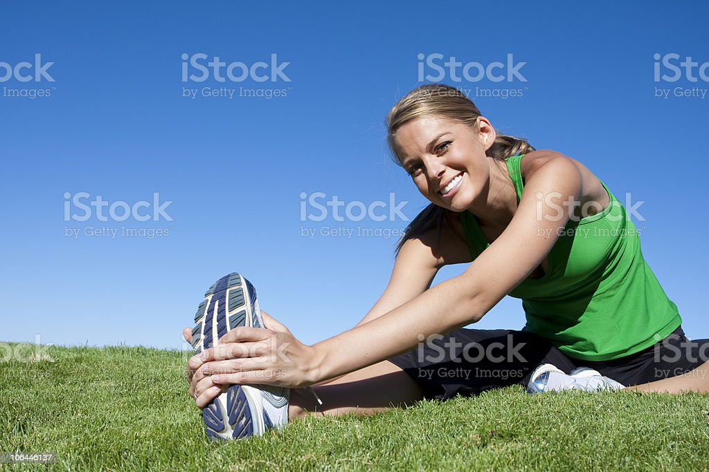 Stretching before Fitness & Exercise stock photo