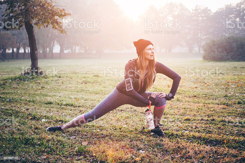 Stretching before jogging stock photo