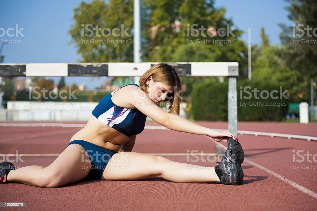 Stretching before race royalty-free stock photo