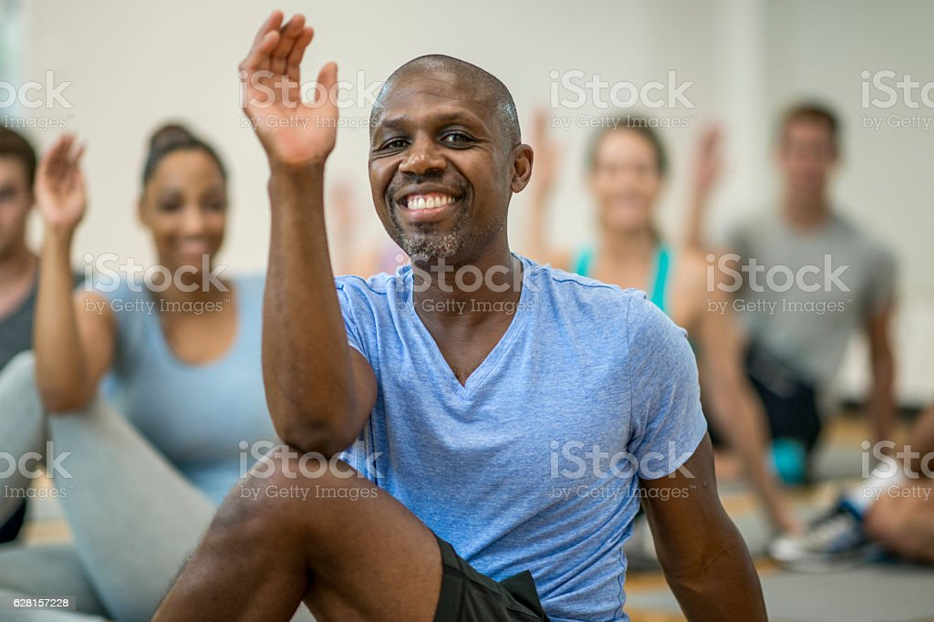 Stretching during a Yoga Class stock photo