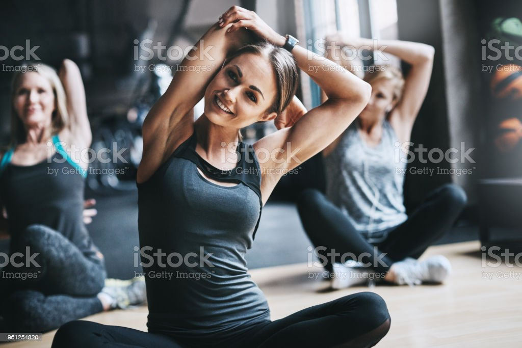 Stretching every muscle before working out stock photo