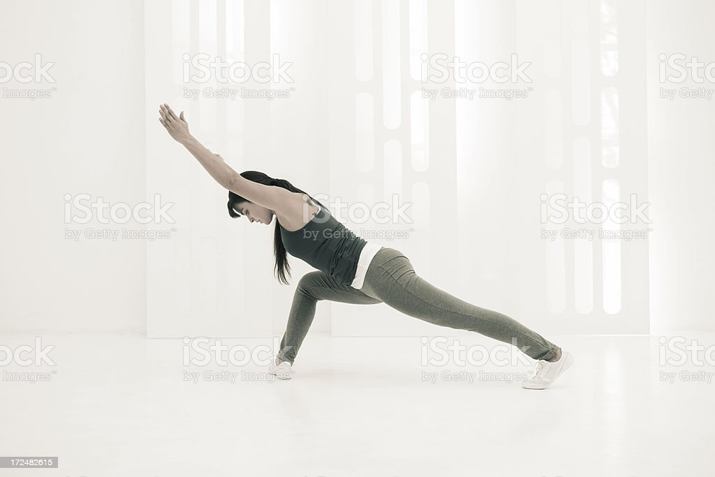 Stretching exercises in white gym royalty-free stock photo