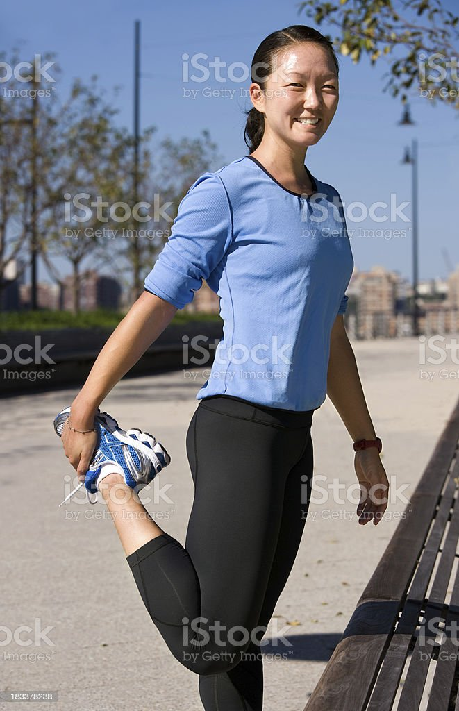 Stretching for warm up or cool down royalty-free stock photo