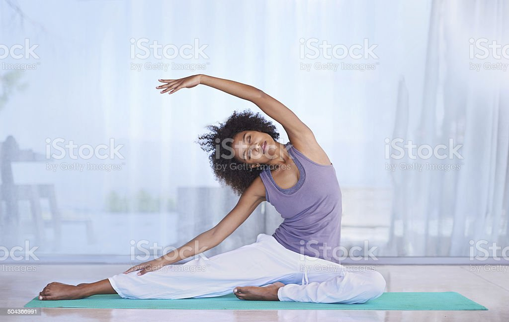 Stretching her sides stock photo