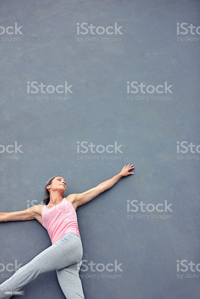 Stretching her way to relaxation stock photo