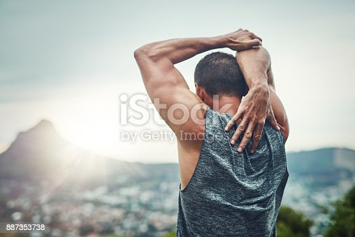 istock Stretching his arms 887353738