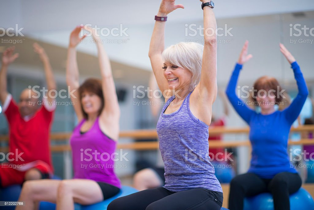 Stretching in an Exercise Class stock photo