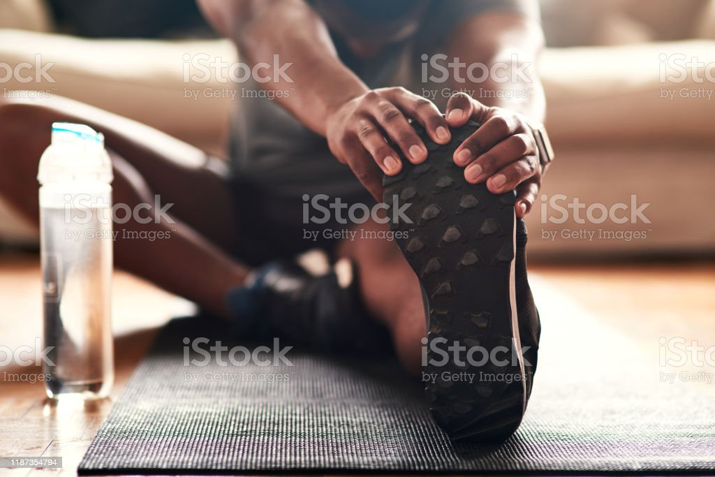 Stretching is something you should be doing every day - Foto stock royalty-free di Abbigliamento casual