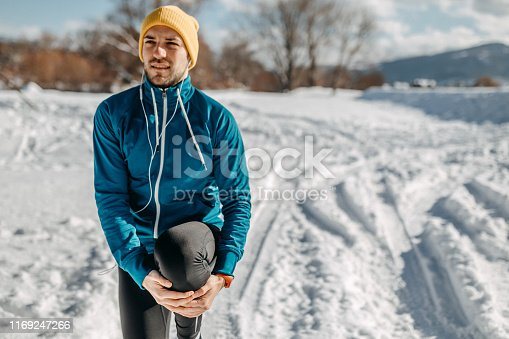 Man stretching for better results on running track