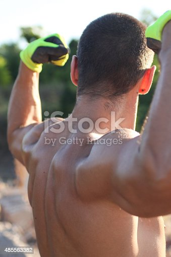 istock stretching male muscle back 485563382