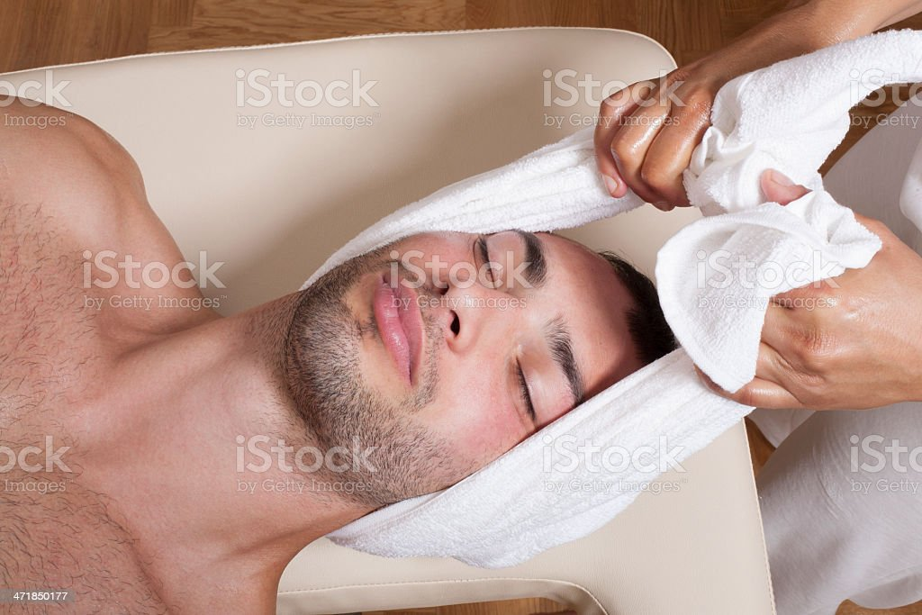 Stretching neck with towel royalty-free stock photo