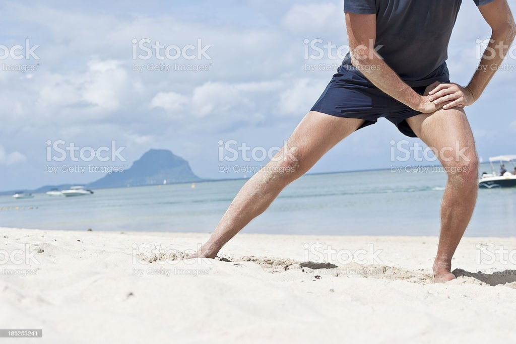 Stretching of adductor muscles stock photo