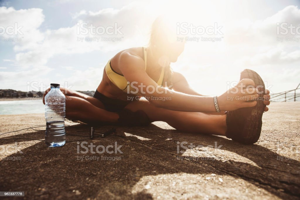 Stretching out after a workout stock photo