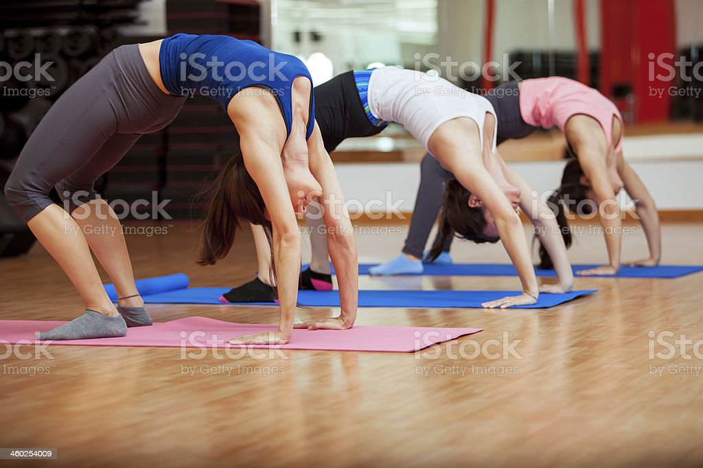 Stretching out for yoga class stock photo