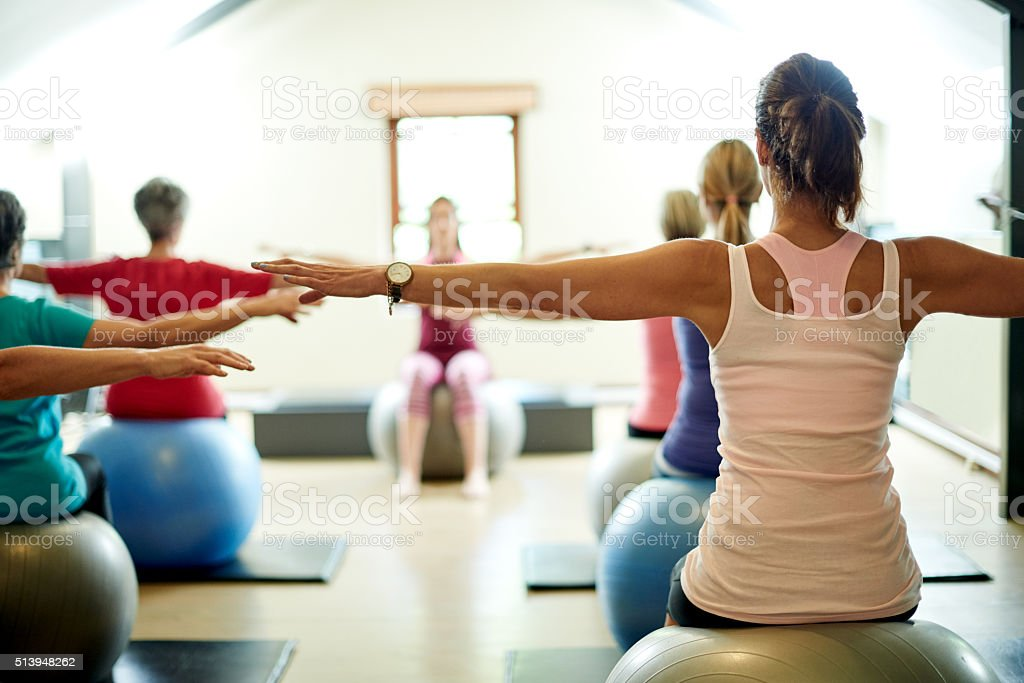 Stretching their way to a stress free life stock photo