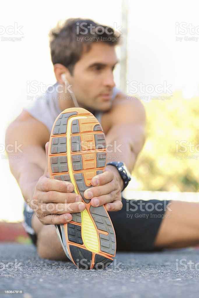 Stretching those muscles before a jog royalty-free stock photo