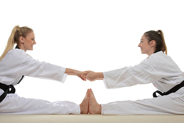 Stretching with a partner stock photo