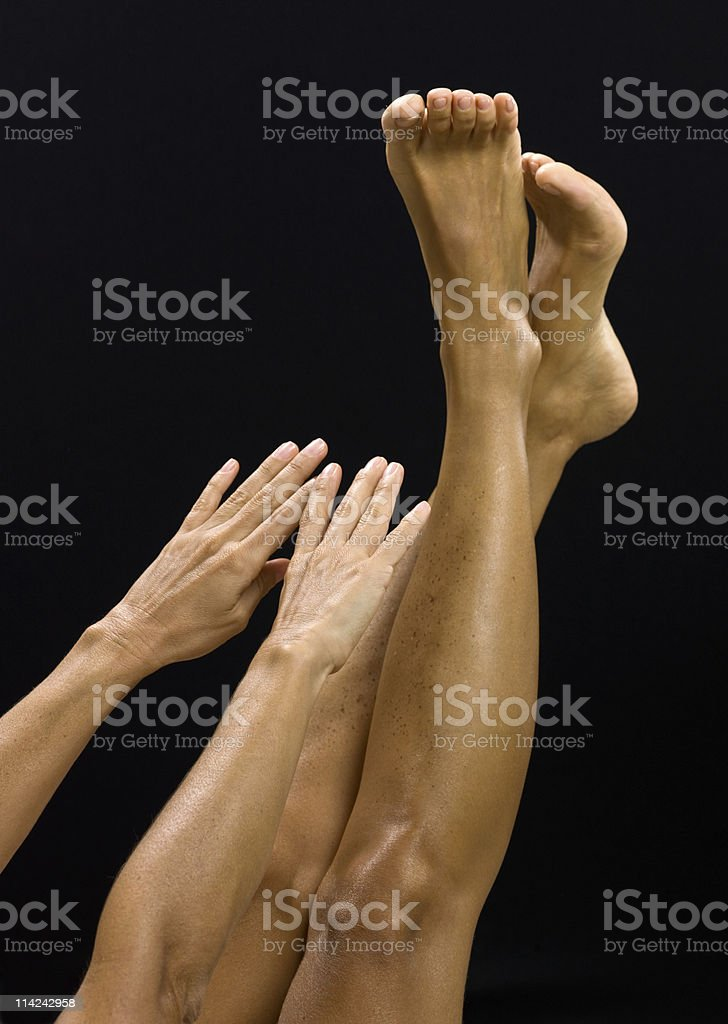 Stretching with hand touching toes royalty-free stock photo