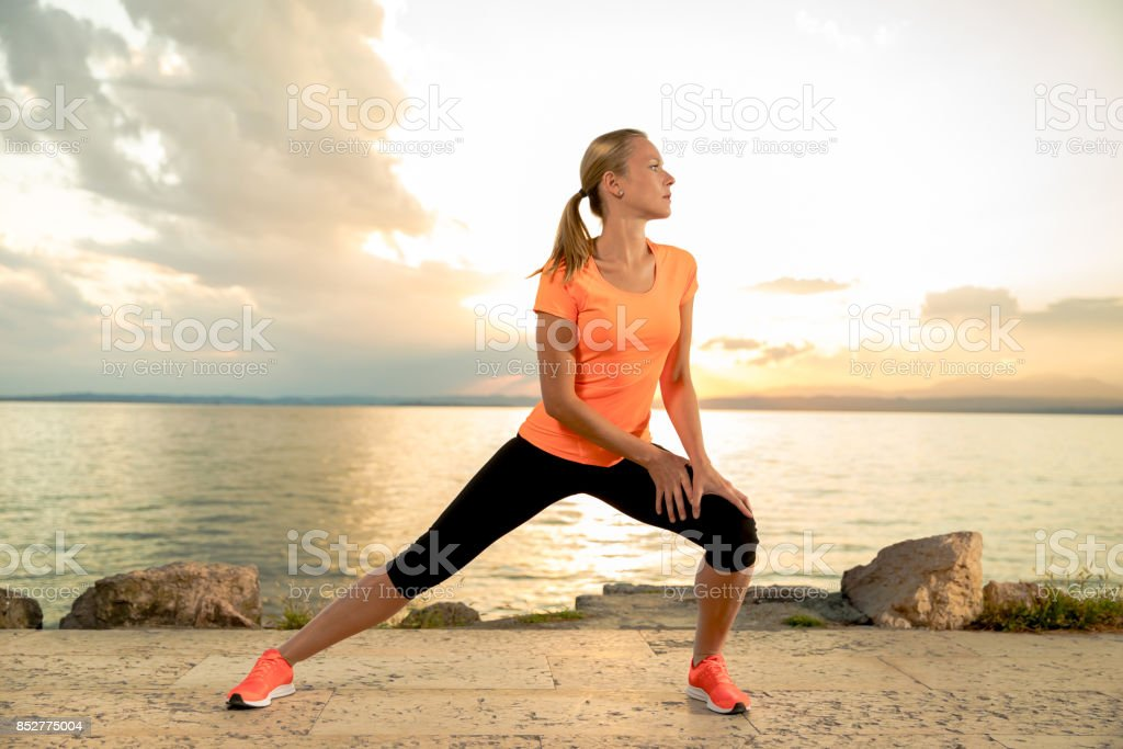 Stretching woman stock photo