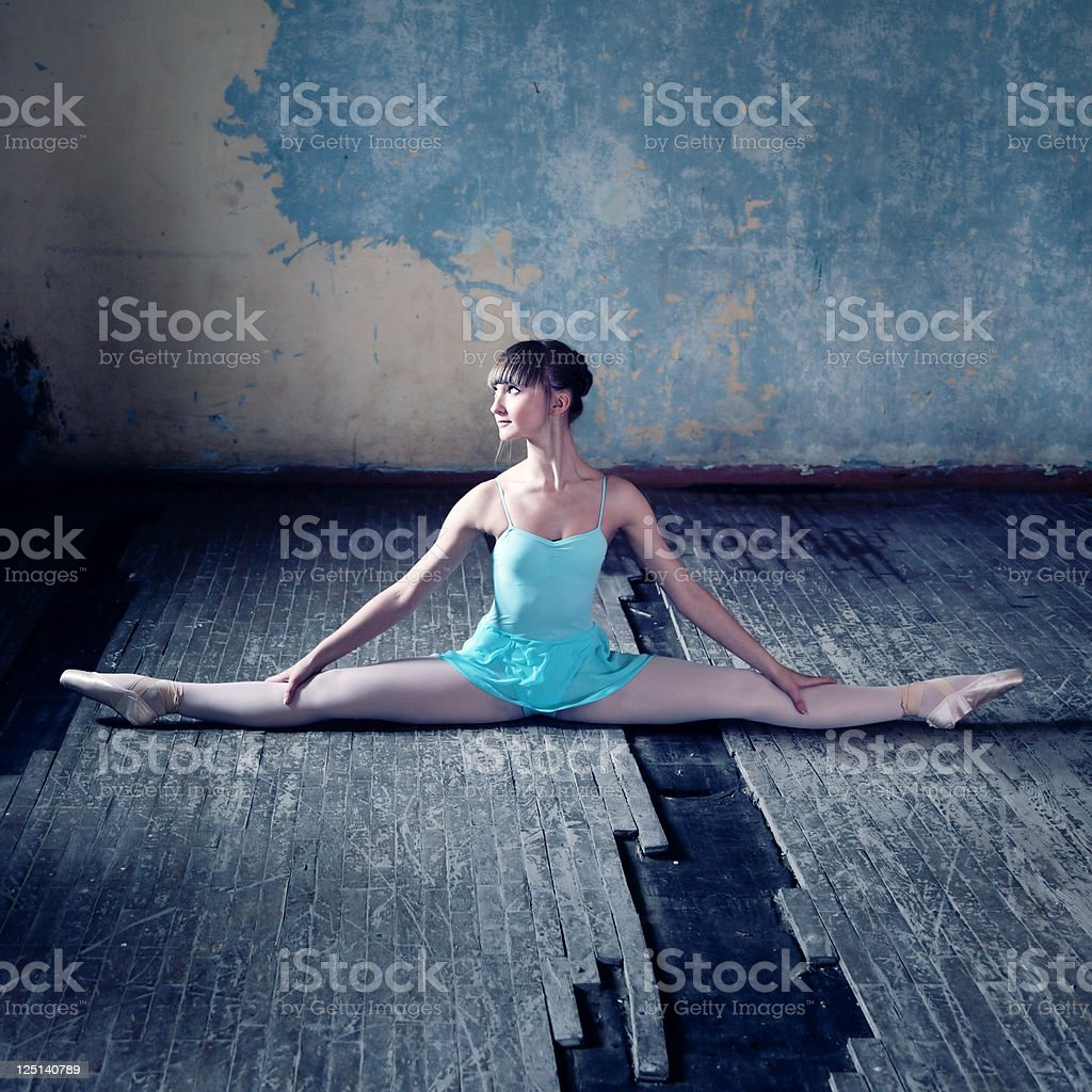 Stretching young ballerina royalty-free stock photo