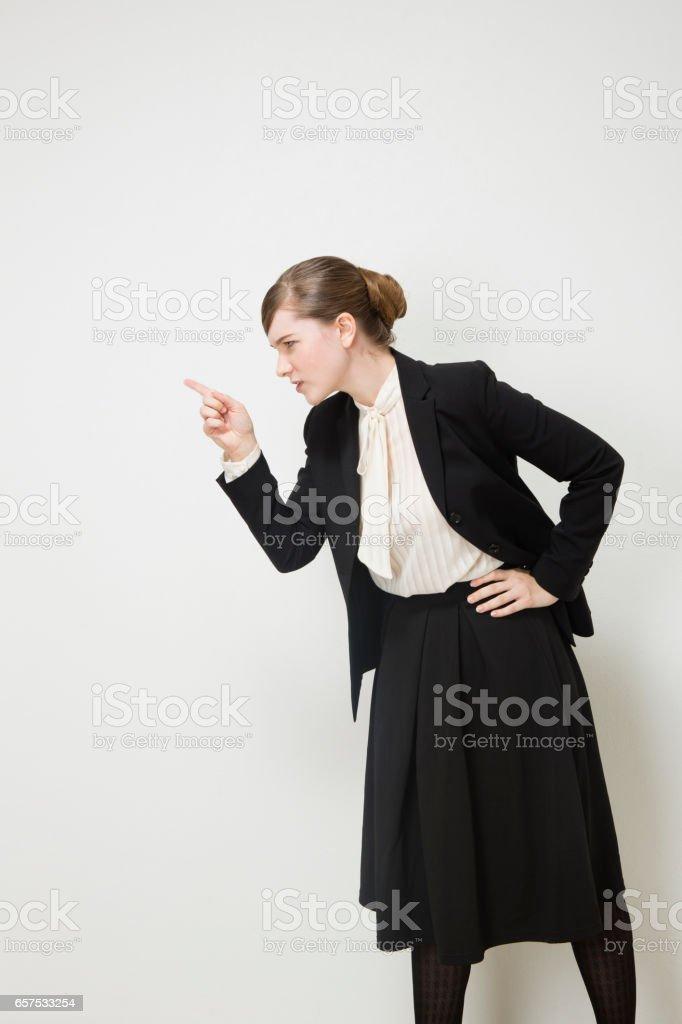 Strict attention to businesswomen stock photo
