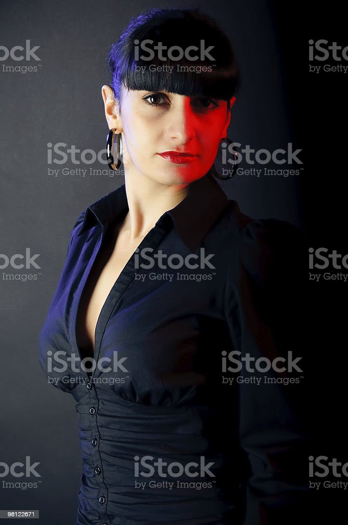 strict girl on neon red and blue light royalty-free stock photo