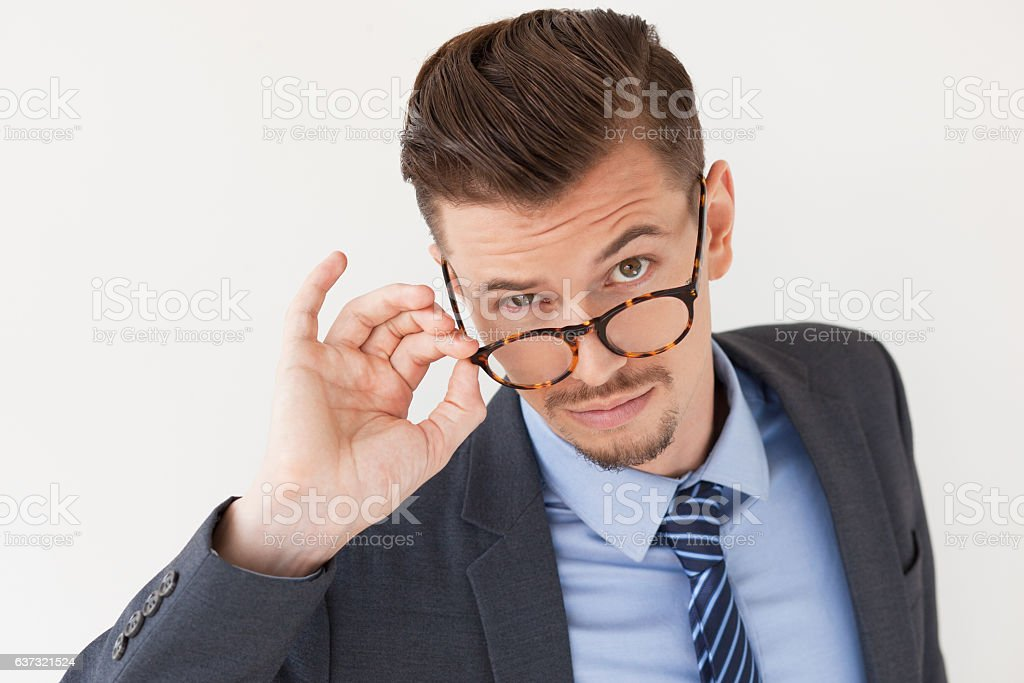 Strict Stylish Business Man Peering Over Glasses stock photo