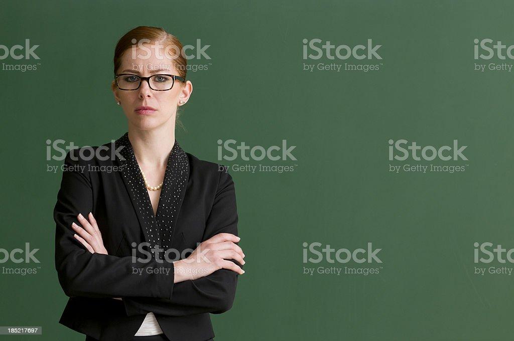 strict teacher at blackboard stock photo