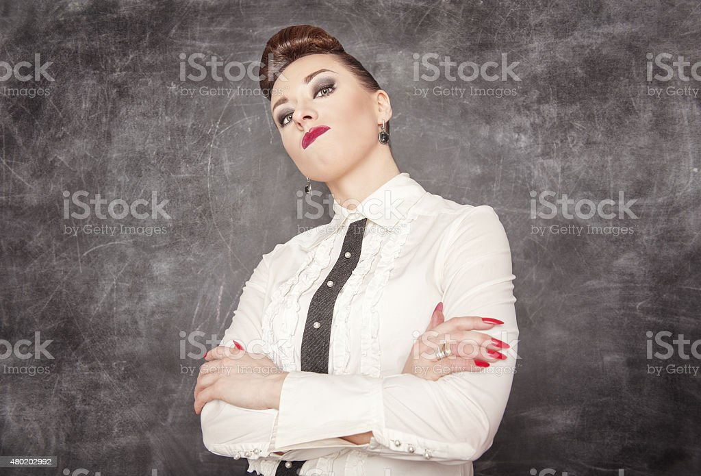 Strict teacher looking at you stock photo