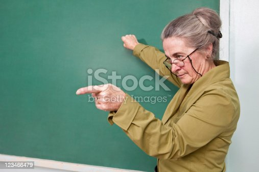 istock Strict teacher pointing at student 123466479