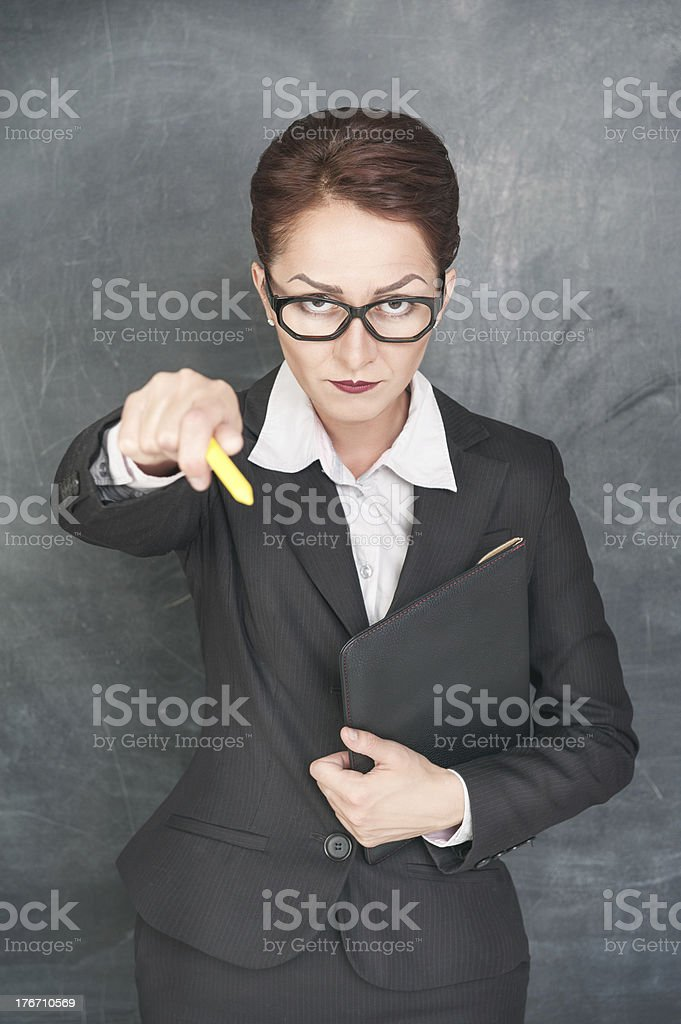 Strict teacher pointing on someone with chalk royalty-free stock photo